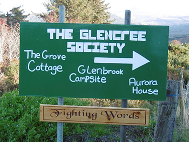 A sign pointing the way to The Glencree Society where Fighting Words Wicklow meet
