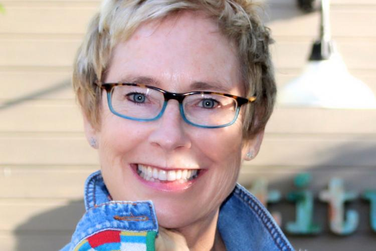 Picture of Cathleen Young, Fighting Words Writing Fellow in association with The Seamus Heaney Centre at Queen's University.  Cathleen is wearing glasses and has short blonde hair.  She is looking directly at the camera and smiling.